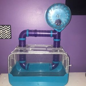 This hamster cage is used but is in good condition